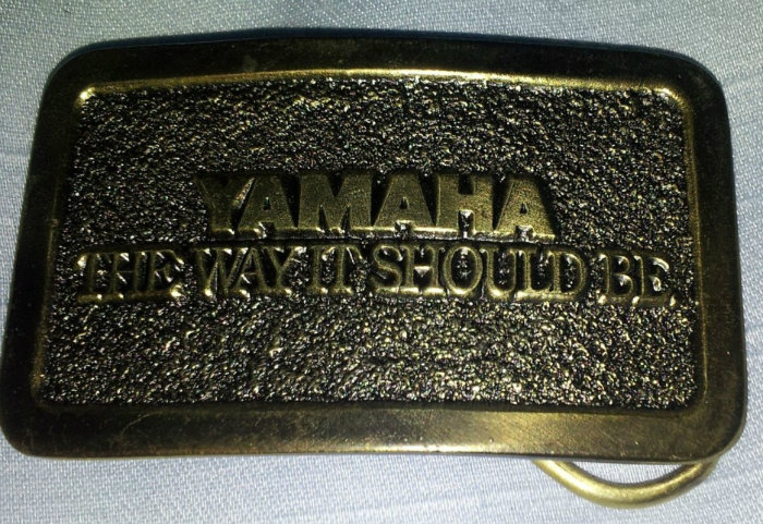 7 .. Yamaha belt buckle